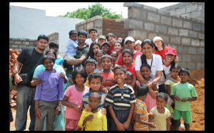The Aasha Build team with the kids of Hegdenagar & the half-built house