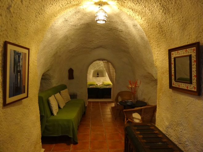 Staying at a cosy cave hotel in Granada.